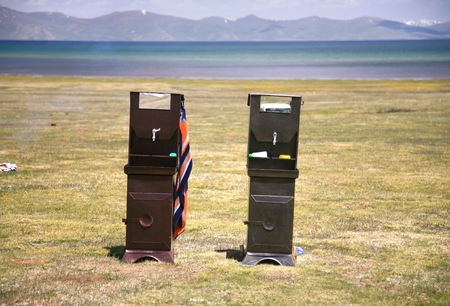 The Local Restroom  at Song kul lake ,  Naryn with the Tian Shan mountains of Kyrgyzstan