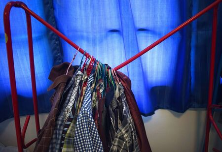 The clothes rack is broken due to unable to support the weight of clothes Фото со стока