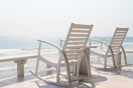 Rocking Chair on the beach Stock Photo