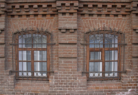 Vintage Windows in a brick house. Stock Photo