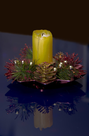An extinct candle on the table. Stock Photo