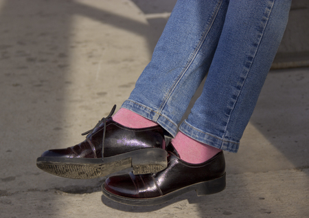 Patent leather shoes with stylish pink socks.