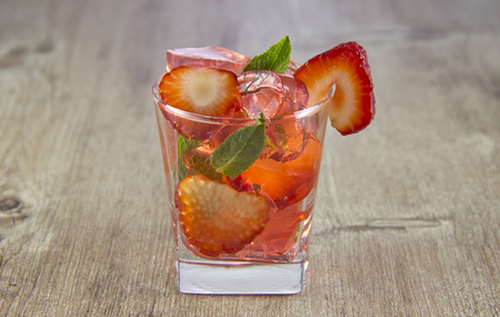 Jelly from strawberry juice with the addition of fresh berries. Were added to the drink ice. Reklamní fotografie