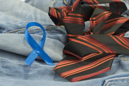 Prostate cancer awareness concept with light blue ribbon on necktie