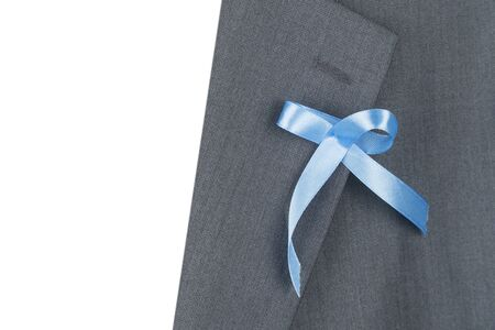 A blue awareness ribbon on the label of the jacket. Stock Photo