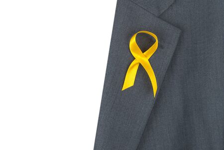 yellow ribbon awareness on the lapel of the jacket.