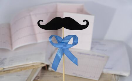 Prostate Cancer Awareness, Blue Ribbon with mustache. Men Healthcare and World cancer day concept.