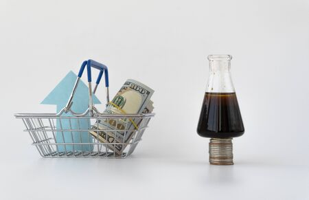 oil and money. the concept of growth in oil prices. futures contract for the purchase or sale of petroleum products. black gold mining.