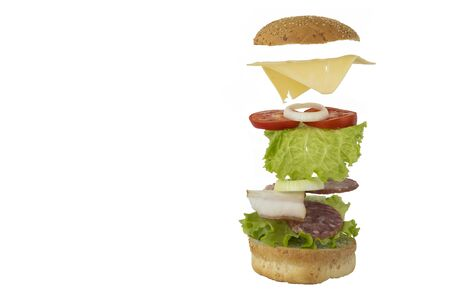 flying sandwich on white background. Food levitation concept. cooking a burger. copy space. concept of making fast food.