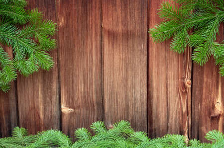green Christmas tree on a wooden vintage background. moraine tree and fir branches. copy space Stock fotó