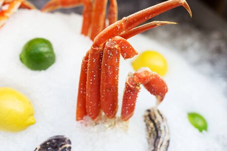 King's crab legs in ice on street food festival of seafood. Concept of luxury food Banco de Imagens