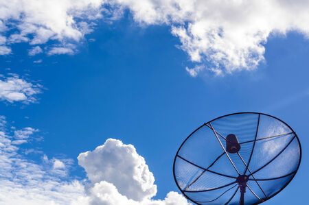 Satellite dish with blue sky in the afternoon