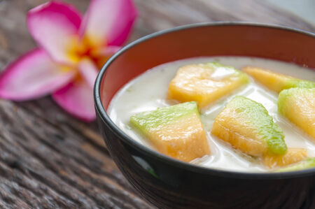 Thai cantaloupe melon in syrup with coconut milk photo
