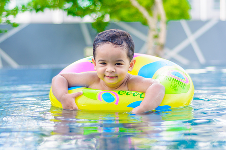 kids swimming pool: Boy in the outdoor swimming pool