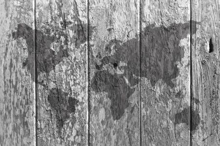 grey scale: Old wooden window with world map in grey scale, textures