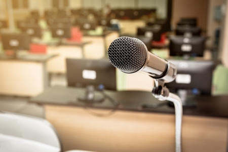 Microphone in the computer room for talker with defocused background, selective focus on microphone Stock Photo