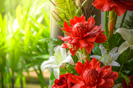 Bunch of beautiful flowers decoration include torch ginger and white lily with natural background.