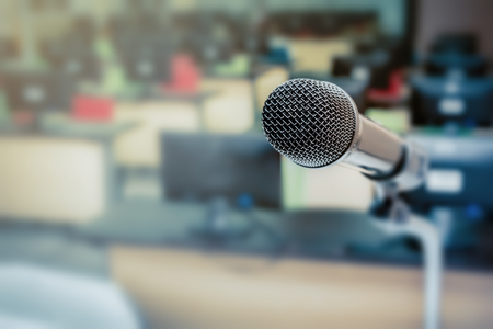 Microphone in the computer room for talker with defocused background, selective focus on microphone