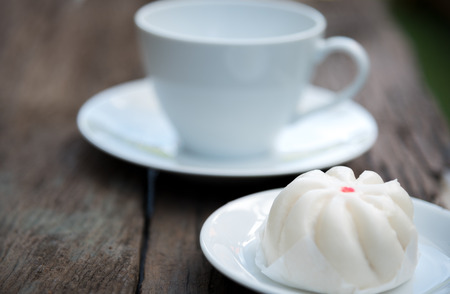 Hot steamed dumpling,chinese buns,pork bun with coffee cup