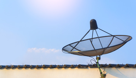 sattellite dish communication industry on roof with blue sky background