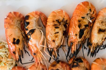 Grilled shrimp. Seafood, shelfish. Shrimps Prawns on white plate
