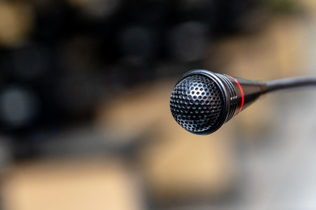 Microphone in the computer room for talker  announcement to listener with de-focused background, selective focus on microphone
