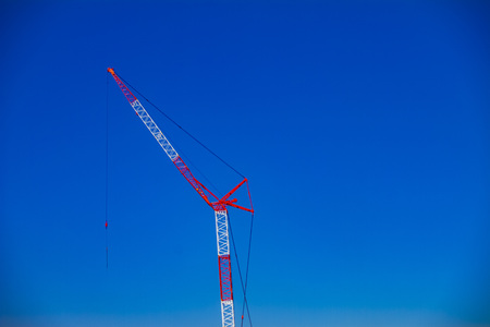 Cranes behind the sky at the under construction wide shot