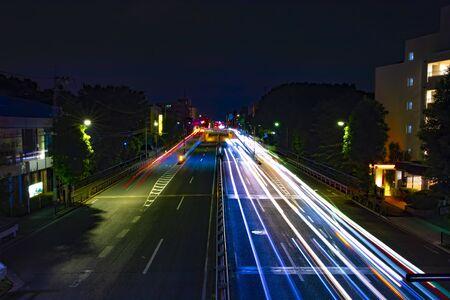 A night city street at the downtown in Setagaya Tokyo wide shot