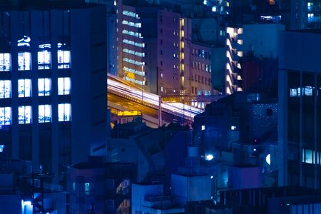 A night highway at the urban city long shot. Bunkyo district Suidobashi Tokyo  Japan - 11.11.2019