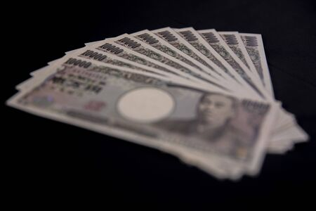 Japanese currency 100,000 yen on the black background