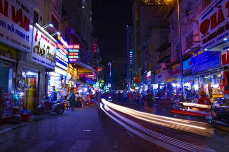 A night neon street at Ben Thanh market in Ho Chi Minh Vietnam wide shot