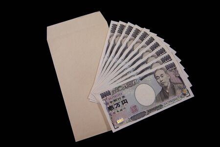 Japanese currency 100,000 yen with envelope on the black background