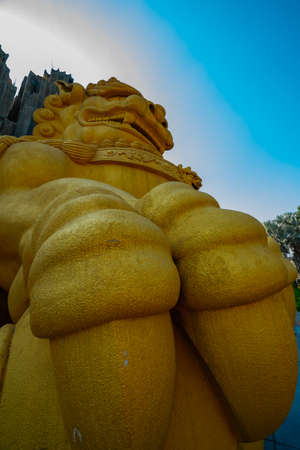 A Big Statue Guardian dog at Suoi Tien park in Ho Chi Minh low angle