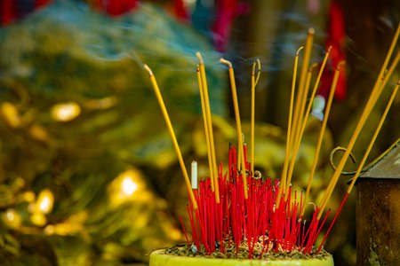 An incense stick at Suoi Tien park in Ho Chi Minh Vietnam closeup