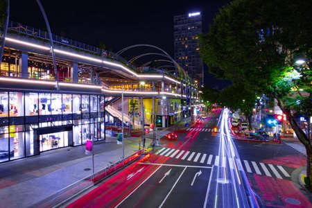 A night urban city street in Shibuya Tokyo wide shot