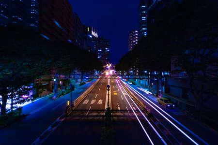 A night urban city street on the highway in Shinjuku wide shot