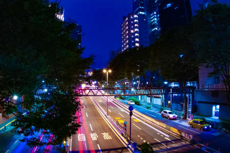 A night urban city street on the highway in Shinjuku wide shot Banque d'images - 157438932