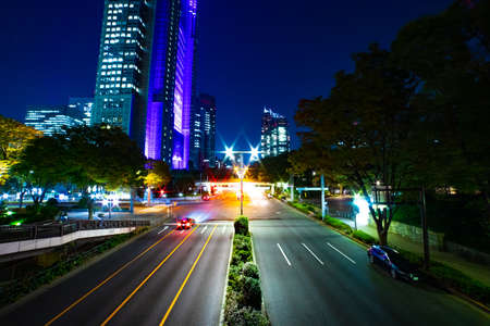 A night urban city street near Tokyo Metropolitan Government in Shinjuku wide Banque d'images - 158111225