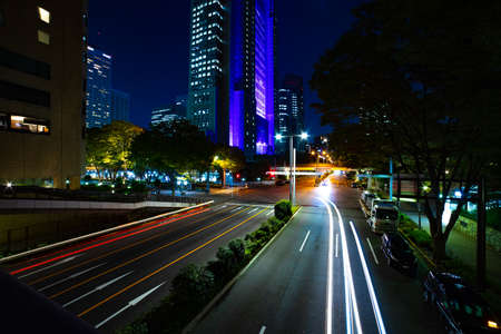 A night urban city street near Tokyo Metropolitan Government in Shinjuku wide Banque d'images - 158111535