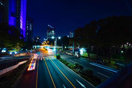 A night urban city street near Tokyo Metropolitan Government in Shinjuku wide Banque d'images - 158111136