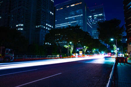 A night urban city street in Shinjuku wide shot