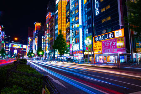 A night neon street in Shinjuku wide shot