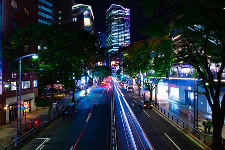 A night neon street in Shibuya wide shot