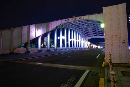A night city street near Kachidoki bridge in Tokyo wide shot Banque d'images - 158974866