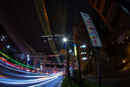 A night city street under the highway in Tokyo fish eye shot