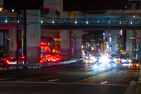 A night city street under the highway in Tokyo middle shot