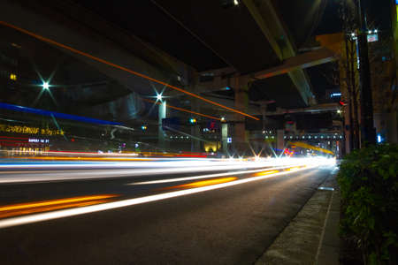 A night city street under the highway in Tokyo wide shot Standard-Bild