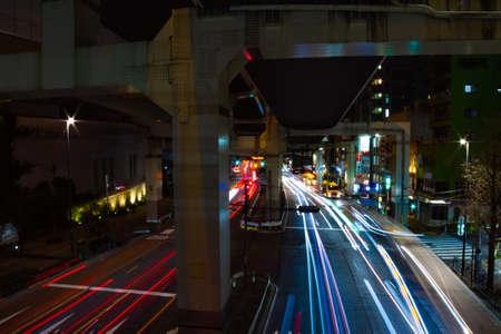 A night city street under the highway in Tokyo wide shot Standard-Bild