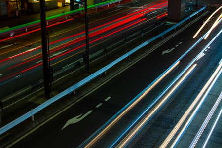 A night traffic on the urban street in Ikejiriohashi long shot
