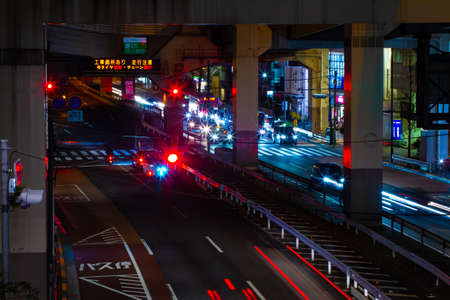 A night traffic on the urban street in Ikejiriohashi middle shot